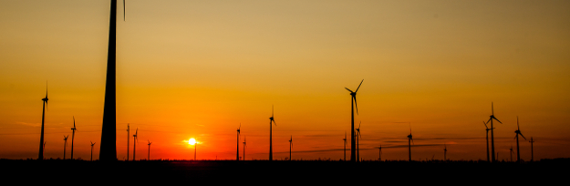 Array of wind power station at the sunset