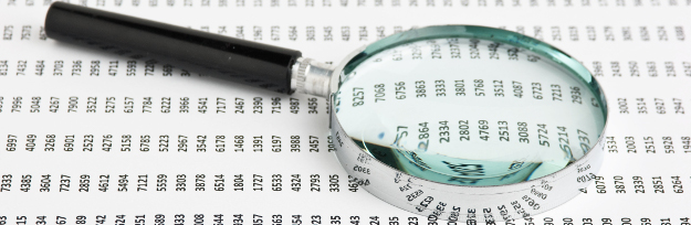 magnifying glass on a document with columns of figures